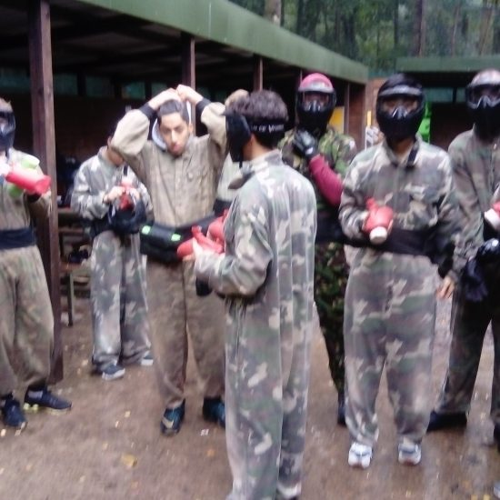 group of boys in paintballing gear